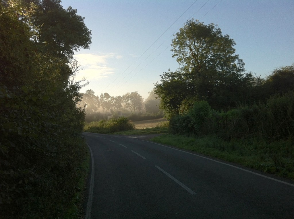 Photograph of road ahead, with sunrise